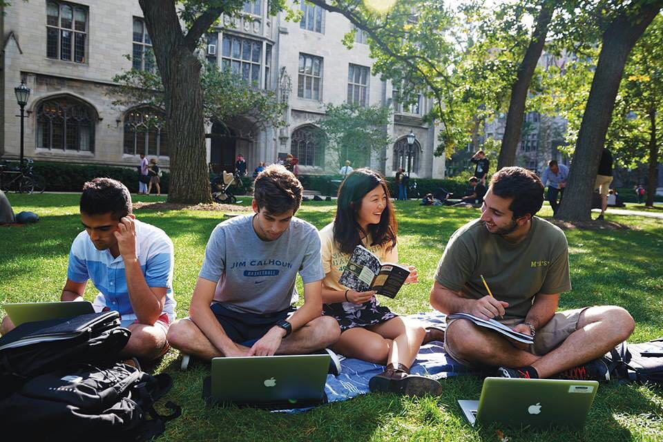 Students on the Main Quadrangles with laptops